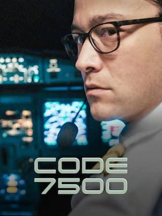 Ein Mann im Cockpit eines Flugzeugs schaut über seine Schulter, blickt Richtung Kamera.