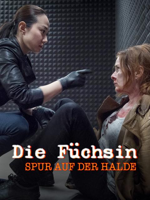 Ex-Stasi Spionin Anne Marie Fuchs (Lina Wendel) wird von einer Frau bedroht.