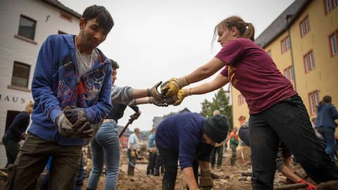 Residents cleaned up mud and debris in Bad Muenstereifel's town center on Saturday, in Bad Munstereifel, Germany, July 17, 2021.