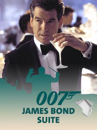 Pierce Brosnan alias James Bond 007 trinkt einen Martini - Teaserplakat zur Aufnahme der Filmmusik mit dem WDR Funkhausorchester