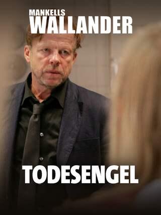 Kurz Wallander spricht mit einer Frau.