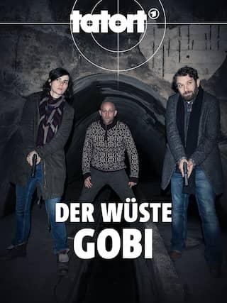 Nora Tschirner und Christian Ulmen mit Waffe in der Hand, dazwischen Jürgen Vogel