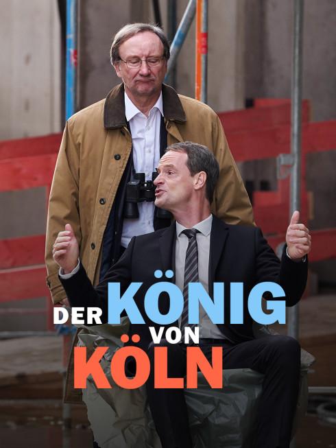 zwei Männer vor Baustelle mit Anzug