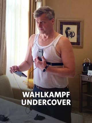 Ein Mann mit verkabelter Kamera auf dem Hemd
